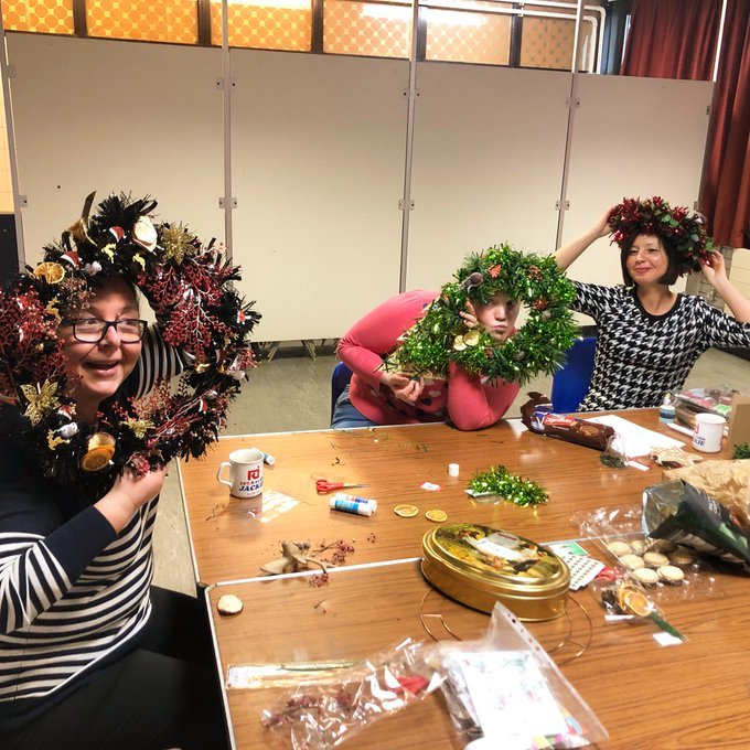 Caseworker Pippa and members at Craftivism and Chat making Christmas Wreathes